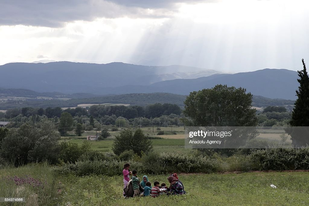 Some refugees, escaping from the evacuation in Idomeni, wait at another refugee camp near Idomeni, Greece on May 25, 2016.