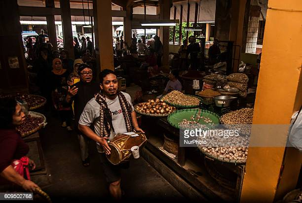 Some residents from Forum Actor Yogyakarta performance theater in traditional market Beringharjo Yogyakarta Indonesia on September 21 2016 This...