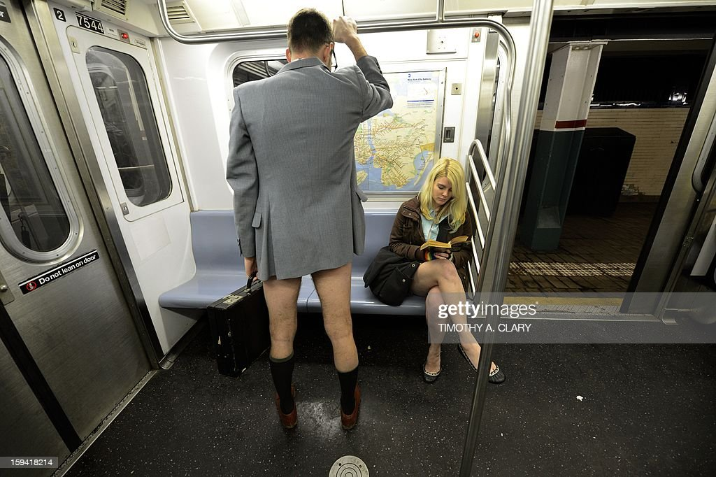 Some riders in the New York City subway in the underwear as the take part in the 2013 No Pants Subway Ride January 13, 2013. Started by Improv Everywhere, the goal is for riders to get on the subway train dressed in normal winter clothes (without pants) and keep a straight face. AFP PHOTO / TIMOTHY A. CLARY