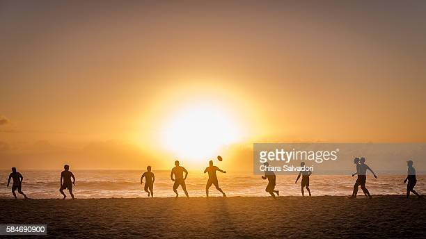 Some rugby players play rugby football on the beach of Camps Bay, South Africa