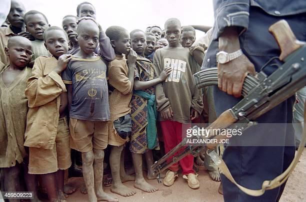 Some Rwandan Hutu children watch on April 01 1995 Burundian soldiers at Gashoho about 60 kms from Burundi's border with Tanzania where some 55000 of...