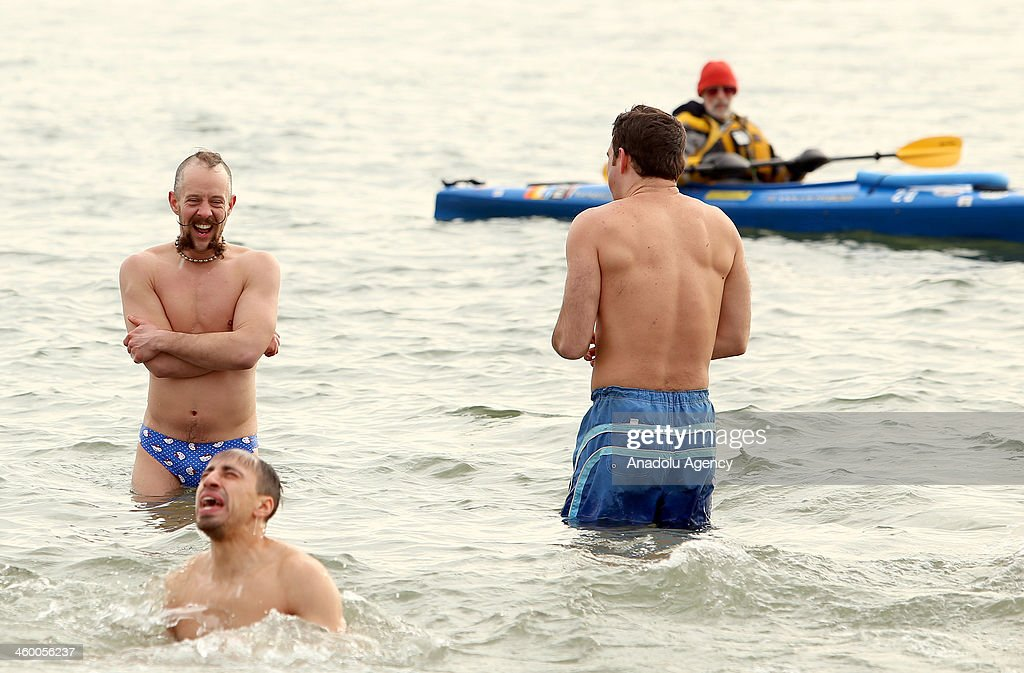 Some thousands of swimmers took a dip in the Atlantic Ocean at Coney Island Wednesday as part of the annual Polar Bear Club dip, January 1, 2014.