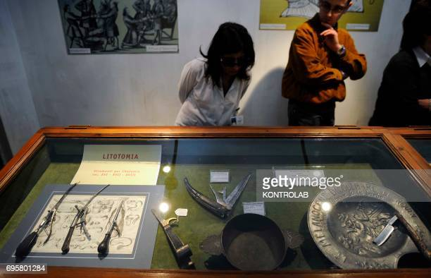 Some tourists visit the Museum of the History of medicine and Health into Incurabili hospital in Naples City