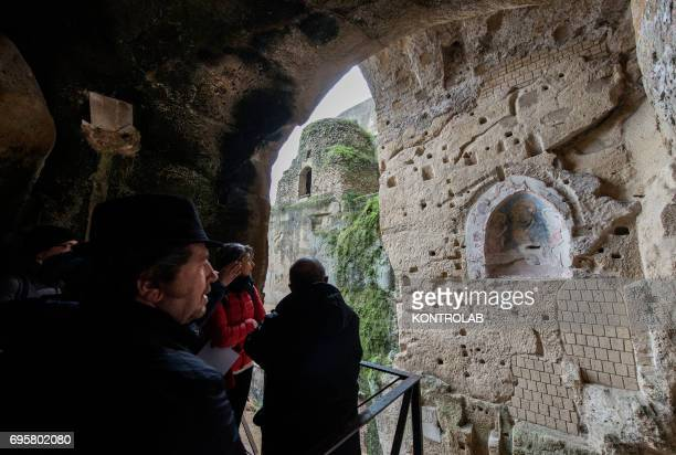 Some tourists visit the Publio Virgilio Marone and Giacomo Leopardi tombs in the Virgiliano park on Piedigrotta downtown Naples
