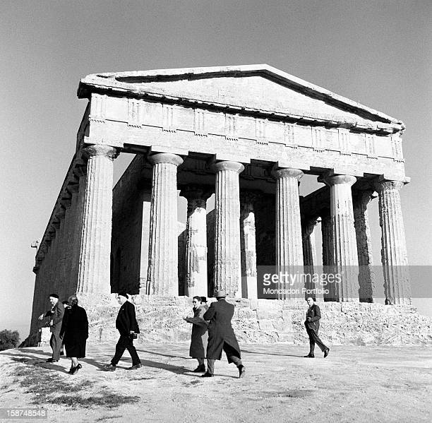 Some tourists visiting the Greek Temple of Concordia Agrigento 1955