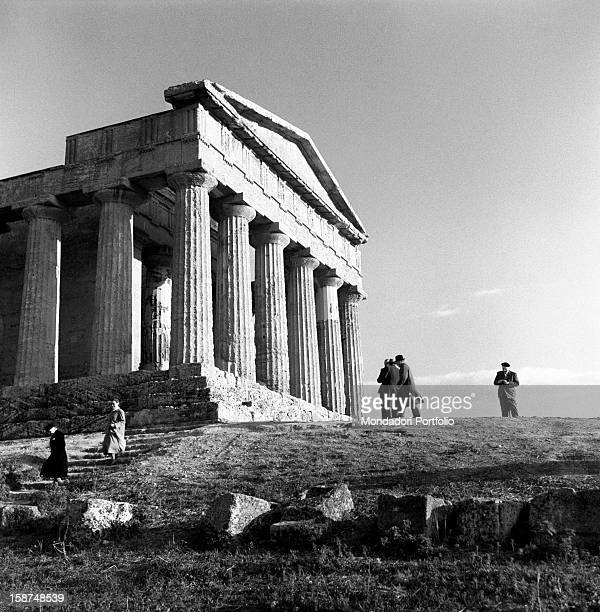 Some tourists visiting the Greek Temple of Concordia here in foreshortened view Agrigento 1955