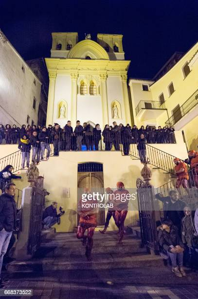 Some Vattienti move in procession during the ritual of Vattienti that takes place on the night between Holy Thursday and Holy Friday during Holy Week...
