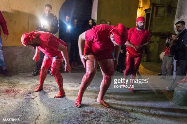 Some Vattienti strike themselves during the ritual of Vattienti that takes place on the night between Holy Thursday and Holy Friday during Holy Week...