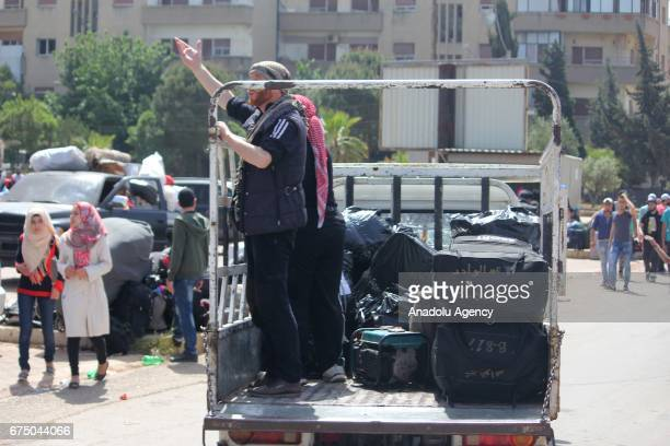 Some vehicles in the 7th evacuation convoy forced to leave the neighborhood of Vaer in the Syrian city of Homs which is under siege by the Bashar...