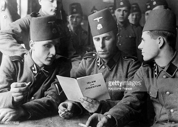 Some Volunteers Of Schutzstaffel Of Bosnian Origin Reading A Brochure About Distinctions Between Islam And Judaism On December 20 1943