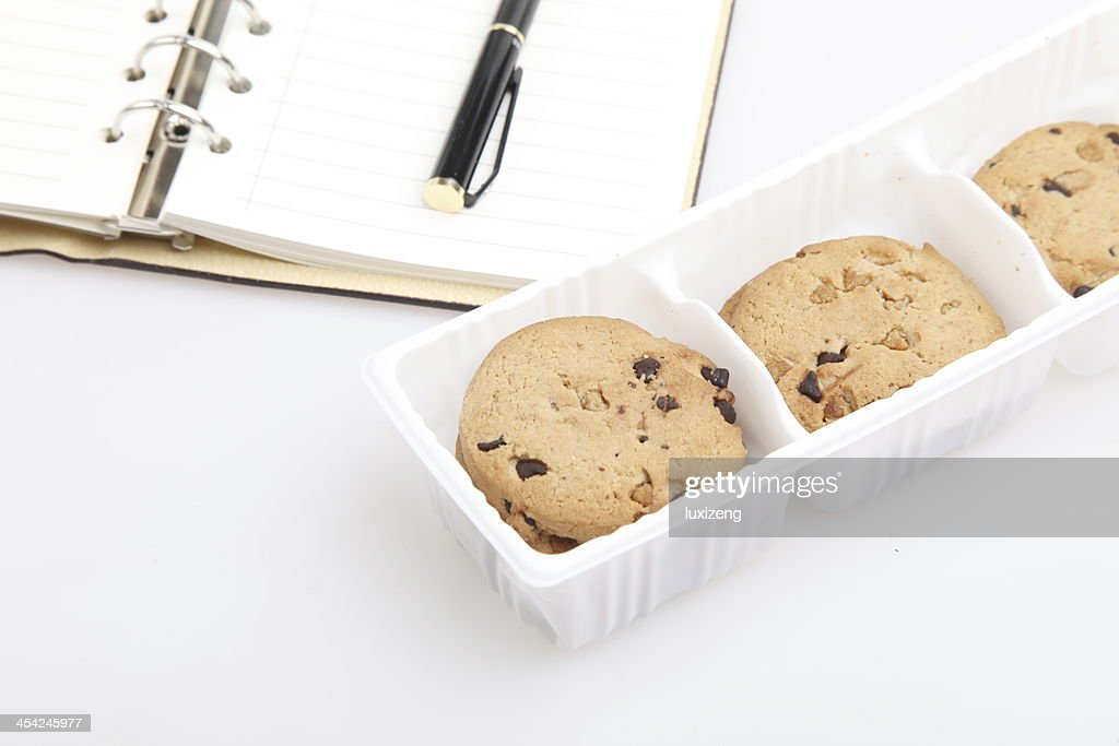 Some wheat biscuits with chocolate on the desk : Stock Photo