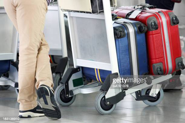 Some women with luggage in cart at the airport