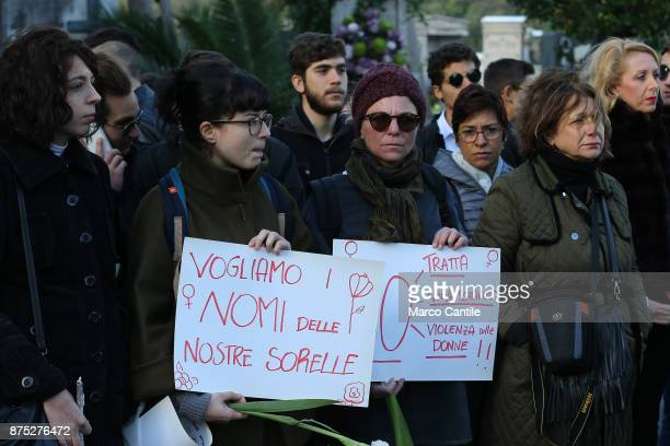 Some women with signs asking for the end of the exploitation of migrants during the funeral of the 28 migrant women who died in a shipwreck as they...