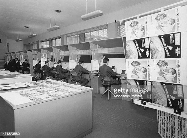 Some workers retouching negatives and slides in the editorial office of the weekly magazine Epoca Italy 1961
