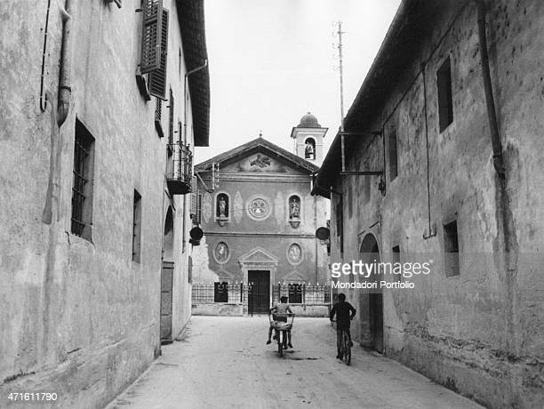 'Some young boys going by bicycle in the streets of Barengo hometown of Renzo Ferrari responsible for the homicide known as the bitter homicide...