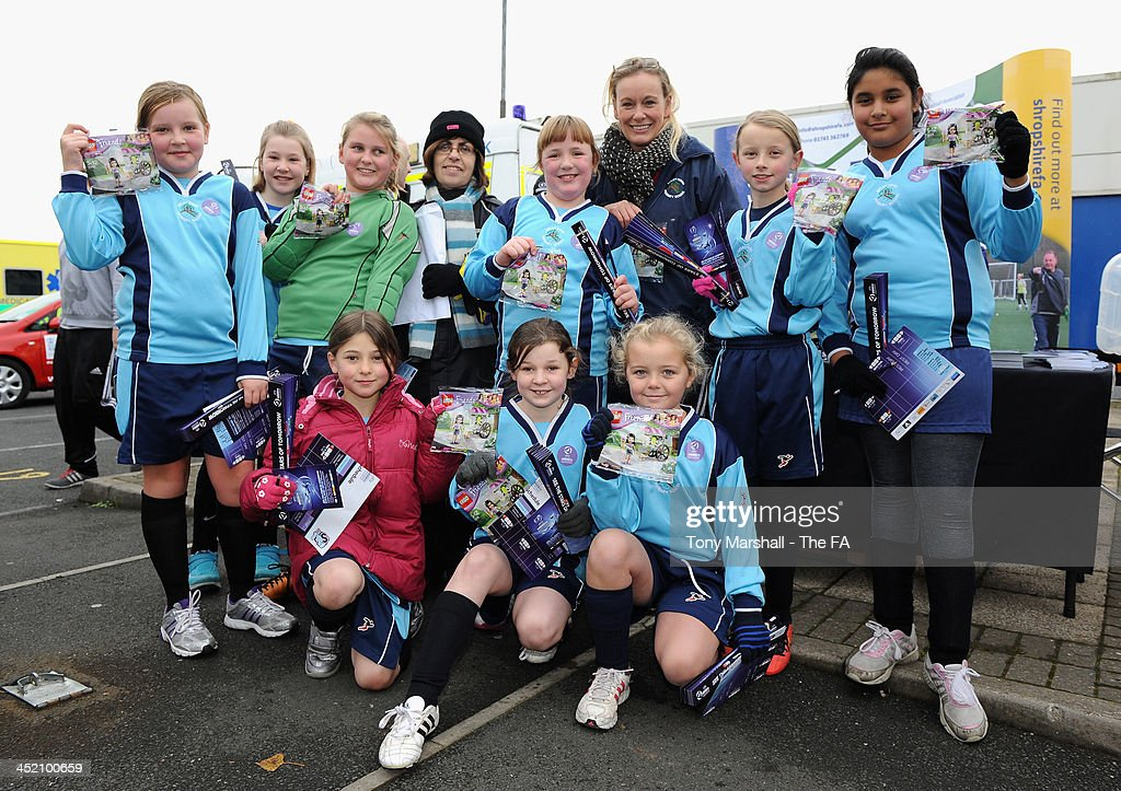 Some young fans with their free Lego, pose during the FA Girls Fanzone before the UEFA Womens U17 Championship Finals match between England and Italy at the AFC Telford New Bucks Head Stadium on November 26, 2013 in Telford, England.