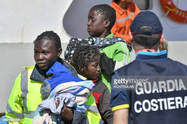 Some young migrants during the landing of migrants by Turkish cargo ship Kaptan Hilmi III in port of Corigliano Calabria southern Italy The refugees...