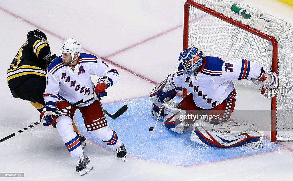 Somehow this puck got by Rangers goalie Henrik Lundqvist, and the Bruins Brad Marchand (#63), left, had an early third period goal that put Boston ahead 4-2. The Boston Bruins hosted the New York Rangers in Game Two of the Eastern Conference semifinals at the TD Garden.