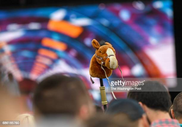 Someone dances with a pony stick in the infield during the 142nd running of the Preakness Stakes at Pimlico Race Course in Baltimore MD on May 20 2017
