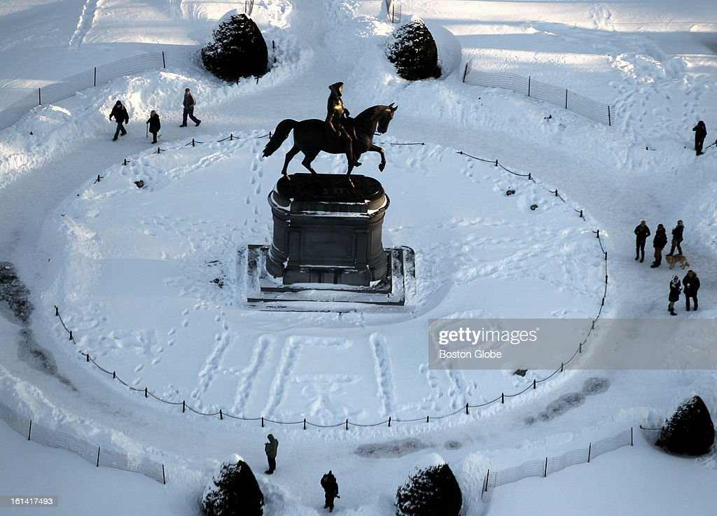 Someone had walked through the snow to write the word, 'HELP,' around the George Washington statue in the Boston Public Garden on Sunday, Feb. 10, 2013, after a blizzard hit New England.