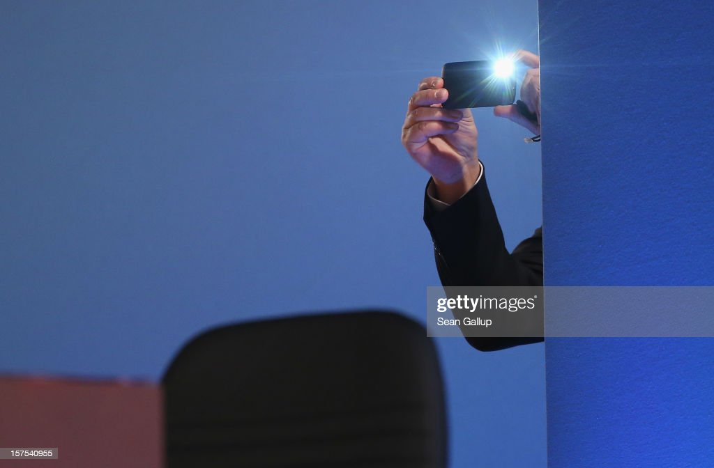Someone snaps a photo with a smartphone at the Christian Democratic Union (CDU) federal party convention on December 4, 2012 in Hanover, Germany. The CDU has a strong lead over its opponents though has recently lost the mayoral posts in several major German cities to opposition parties. Germany faces federal elections in 2013.