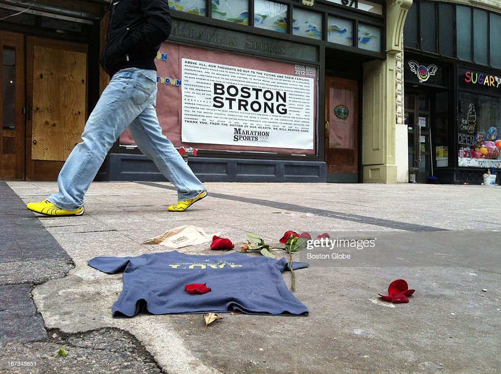 Someone walks past Marathon Sports on Boylston Street on Wednesday, April 24, 2013, shortly after the street was reopened to the public after last week's Boston Marathon bombings.