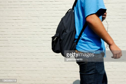 Someone young with a backpack going back to school