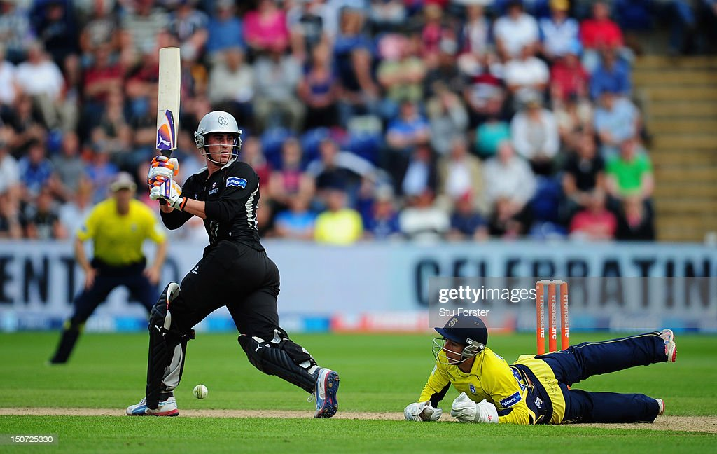Somerset batsman <a gi-track='captionPersonalityLinkClicked' href=/galleries/search?phrase=Craig+Kieswetter&family=editorial&specificpeople=4267430 ng-click='$event.stopPropagation()'>Craig Kieswetter</a> picks up some runs as Hampshire wicketkeeper <a gi-track='captionPersonalityLinkClicked' href=/galleries/search?phrase=Michael+Bates&family=editorial&specificpeople=903251 ng-click='$event.stopPropagation()'>Michael Bates</a> looks on during the Friends Life T20 Semi Final between Hampshire and Somerset at SWALEC Stadium on August 25, 2012 in Cardiff, Wales.