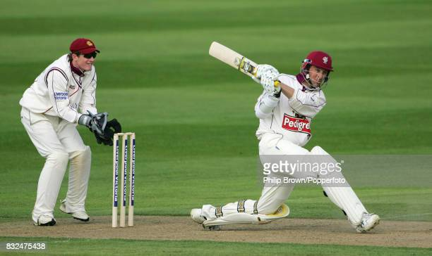 Somerset batsman Marcus Trescothick hits a boundary during his innings of 154 watched by Northamptonshire wicketkeeper Riki Wessels in the County...