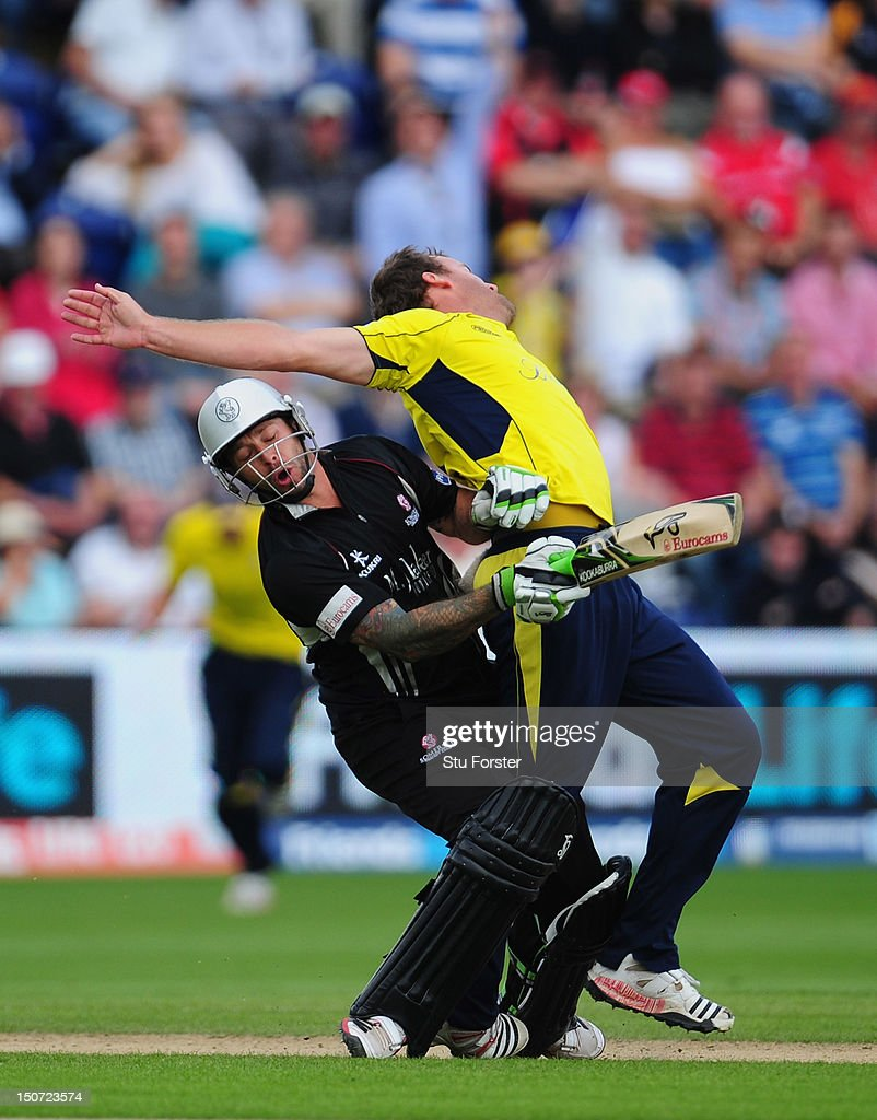 Somerset batsman <a gi-track='captionPersonalityLinkClicked' href=/galleries/search?phrase=Peter+Trego&family=editorial&specificpeople=682859 ng-click='$event.stopPropagation()'>Peter Trego</a> crashes into Hampshire bowler <a gi-track='captionPersonalityLinkClicked' href=/galleries/search?phrase=Sean+Ervine&family=editorial&specificpeople=579552 ng-click='$event.stopPropagation()'>Sean Ervine</a> who had just trapped him lbw during the Friends Life T20 Semi Final between Hampshire and Somerset at SWALEC Stadium on August 25, 2012 in Cardiff, Wales.