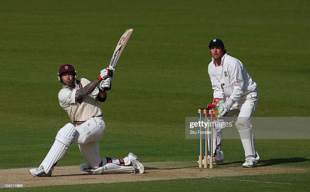 Somerset batsman Peter Trego hits a six watched by Phil Mustard during Day three of the LV County Championship Division One match between Durham and...