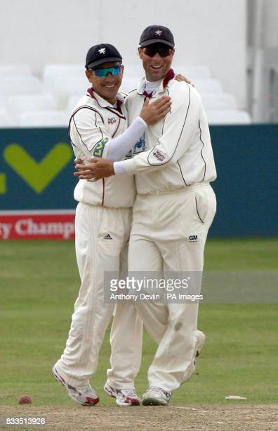 Somerset captain Justin Langer and Marcus Trescothick celebrate after winning the second division title during day three of the LV County...