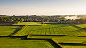 The village of Milbourne Port nestled amongst fields of crops and pasture in south Somerset, England.