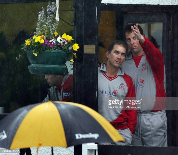 Somerset Sabres captain Justin Langer and Marcus Trescothick watch the rain whichs stops play before Somerset bat during the Friends Provident Trophy...