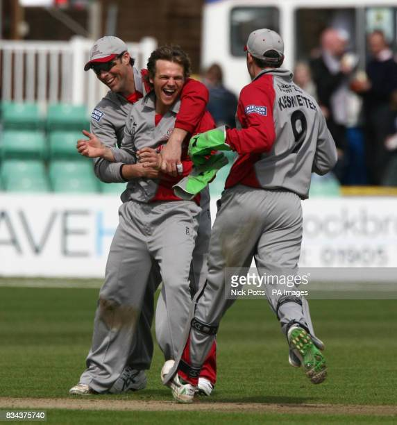 Somerset Sabres' James Hildreth celebrates with Marcus Trescothick after taking wicket of Worcestershire Royals' batsman Kabir Ali during the Friends...