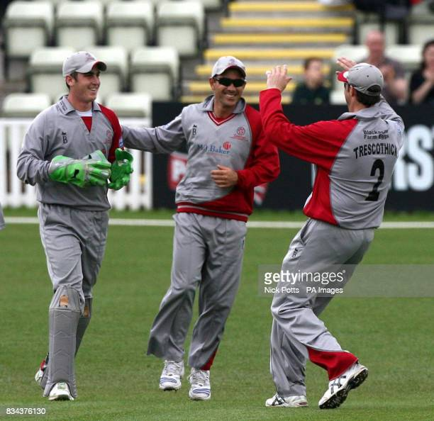 Somerset Sabres' wicketkeeper Craig Kieswetter celebrates with captain Justin Langer and Marcus Trescothick after taking wicket of Worcestershire...