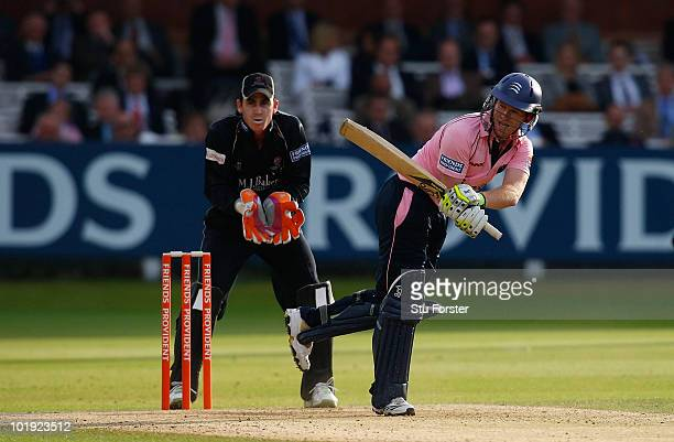 Somerset wicketkeeper Craig Kieswetter looks on as Middlesex batsman Eoin Morgan hits out during the Friends Provident T20 match between Middlesex...