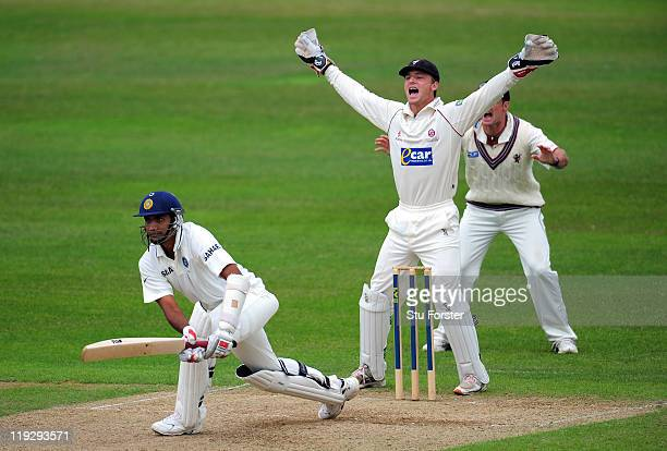 Somerset wicketkeeper Jos Buttler and slip Andrew Strauss appeal with success for the wicket of India batsman Munaf Patel during day three of the...