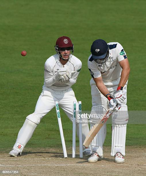 Somerset wicketkeeper Ryan Davies looks on Yorkshire batsman Tim Bresnan is bowled by Jack Leach for 4 runs during day three of the Division One...