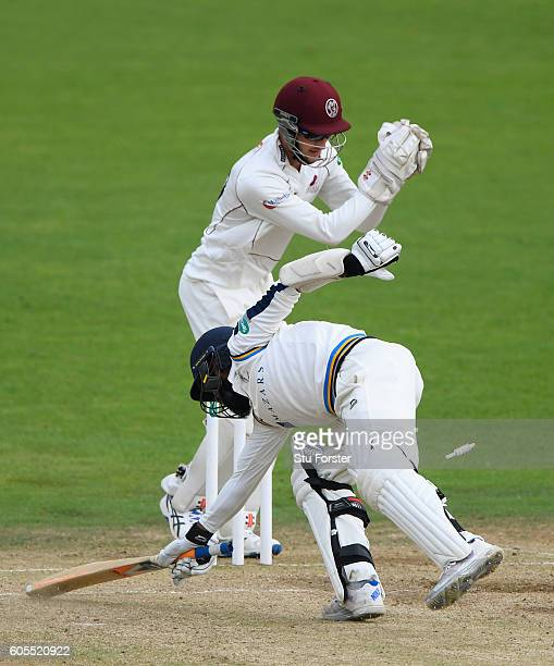 Somerset wicketkeeper Ryan Davies stumps Yorkshire batsman Adil Rashid for 16 runs during day three of the Division One Specsavers County...