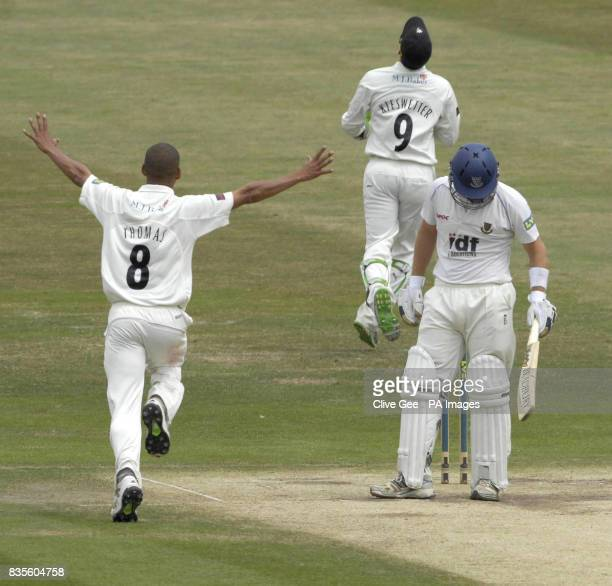 Somerset's Alfonso Thomas celebrates taking the wicket of Sussex's Chris Nash after being caught by Somerset's wicket keeper Craig Kieswetter during...