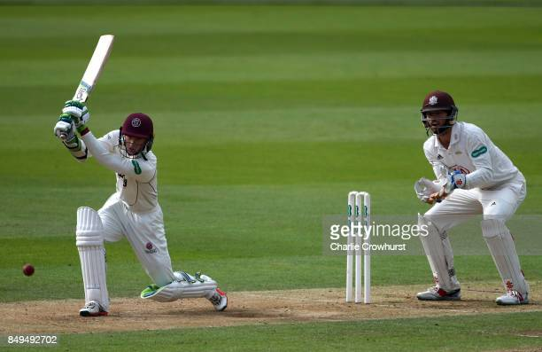 Somerset's Edward Byrom hits out while Surrey keeper Ben Foakes looks on during day one of the Specsavers County Championship Division One match...