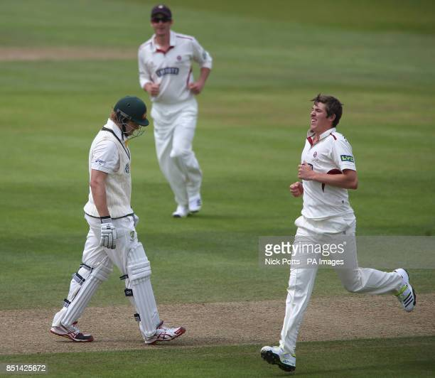 Somerset's Jamie Overton celebrates with his captain Marcus Trescothick after taking the wicket of Australia's Shane Watson for 90 during the...