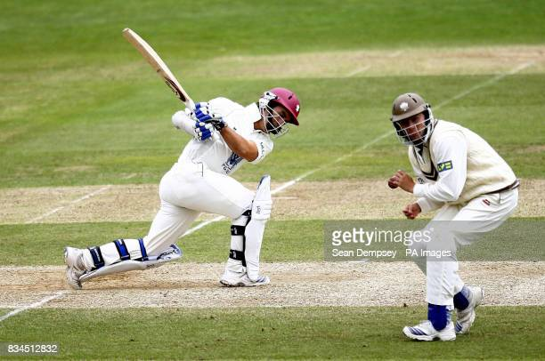 Somerset's Justin Langer hits past Surrey's Chris Murtagh during the LV County Championship match at Whitgift School Surrey