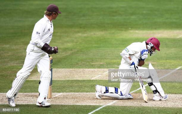 Somerset's Justin Langer is hit by a ball bowled by Mushtaq Saqlain during the LV County Championship match at Whitgift School Surrey
