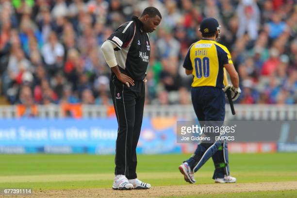 Somerset's Kieron Pollard stands dejected as Hampshire Royal's Shahid Afridi clocks up the runs
