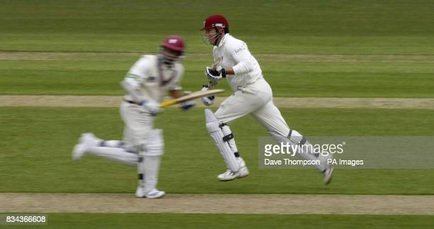 Somerset's Marcus Trescothick right and Justin Langer run between the wickets against Lancashire during the LV County Champonship Division One match...