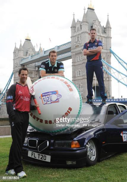 Somerset's Marcus Trescothick Surrey's Chris Tremlett and Essex's Shaun Tait during a photocall to promote the Friends Life Twenty20 at Tower Bridge...