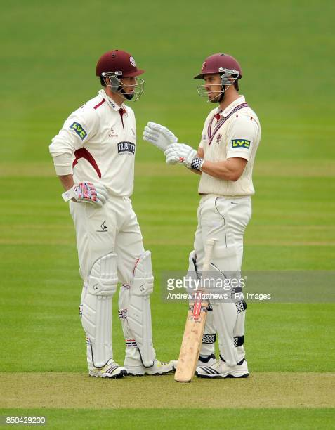 Somerset's Nick Compton has a chat with team mate Marcus Trescothick between overs