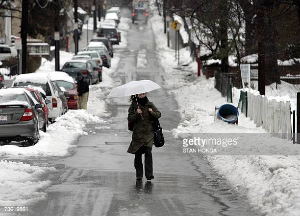 A woman walks down the middle of a street 17 March 2007 on a street in Somerville Massachusetts a day after a snowstorm hit the northeast United...